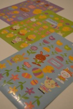 Sheets of leftover stickers, waiting to be cut up.